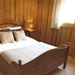 double room in a wooden catered ski chalet