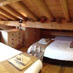 mezzanine bedroom with wooden beams