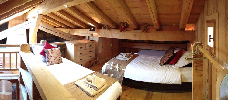 mezzanine bedroom with wooden beams