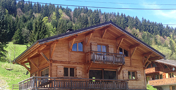 summer chalet in morzine with green back drop