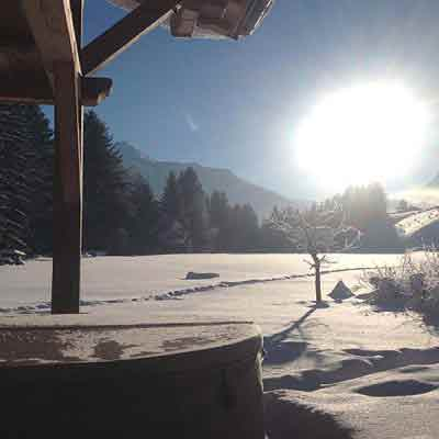 outdoor hot tub with sunny mountain view