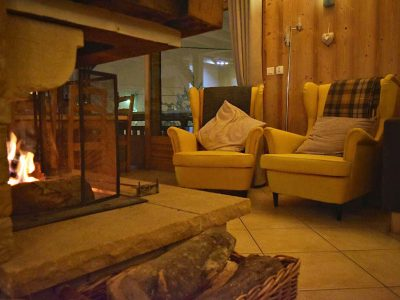 chalet le mousseron morzine fireplace with two arm chairs