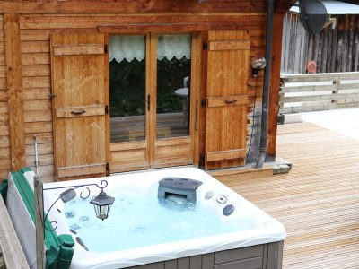 catered chalet morzine with outdoor hot tub on decking