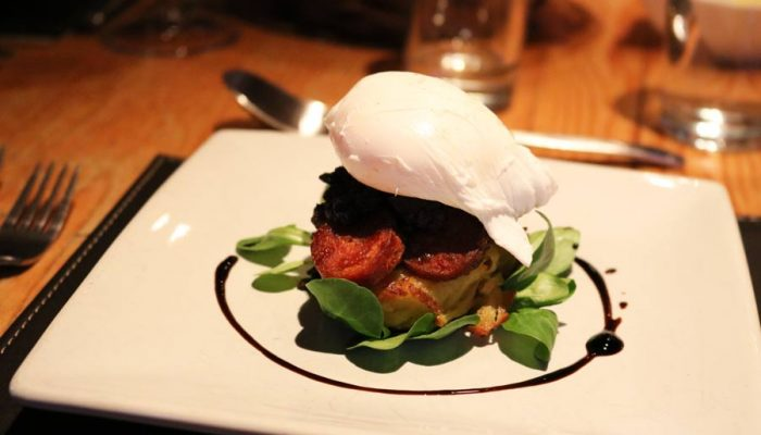 catered chalet food starter black pudding chorizo and poached egg