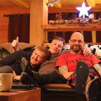chalet holiday guests chilling on sofa