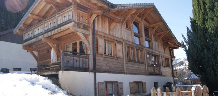 chalet in morzine with snow and sun