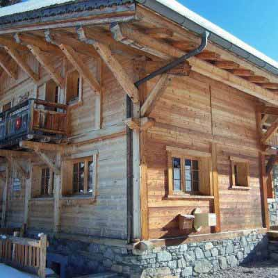 luxury chalet morzine with snow and blue sky