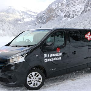 morzine airport transfer minibus with snowy mountain backdrop