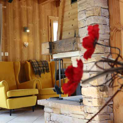 morzine chalet accomodation living area with two yellow armchairs