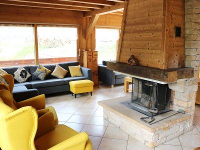 morzine chalet living room with open fire place