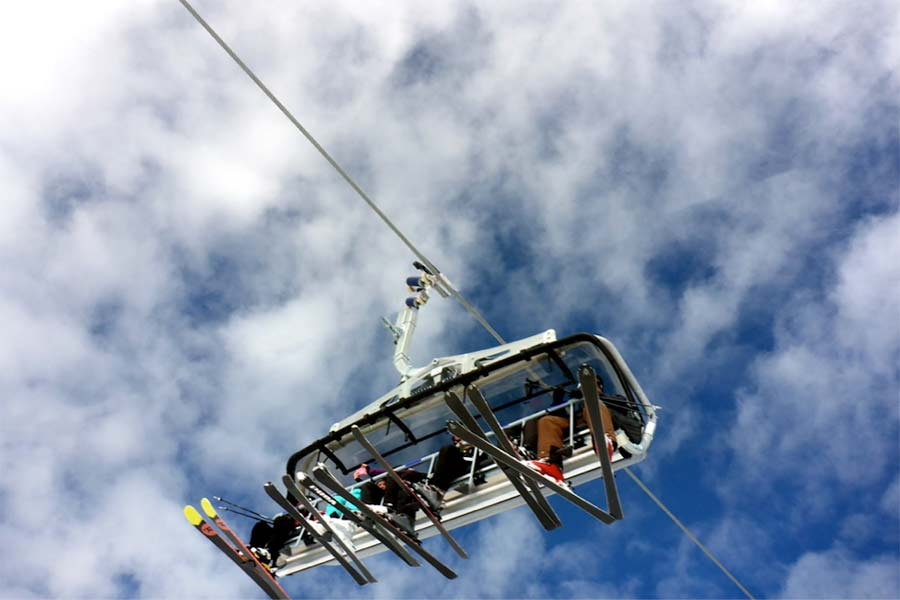 Morzine ski lift with blue sky and scattered clouds